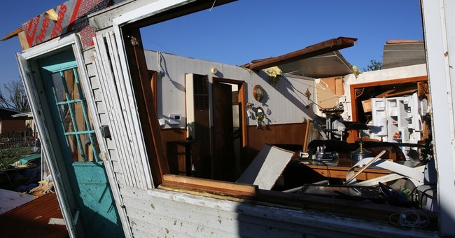 The Latest: Weather Service confirms 9 tornadoes in Illinois