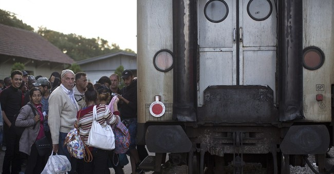 For EU-minded migrants, Hungary 'wall' seen as little hurdle