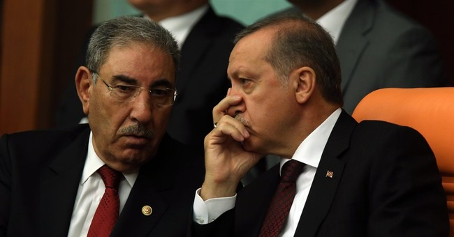 Turkish lawmakers sworn in as coalition questions loom