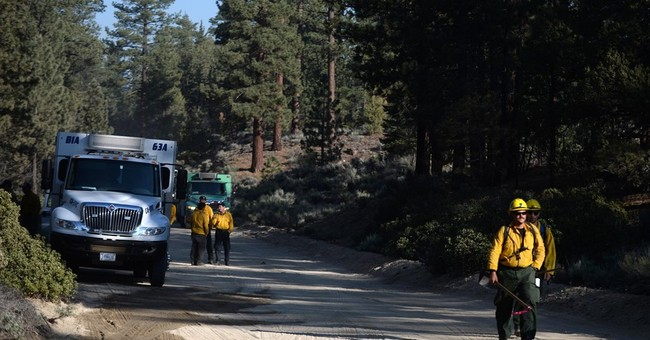 Fire begins near California interstate, threatens homes