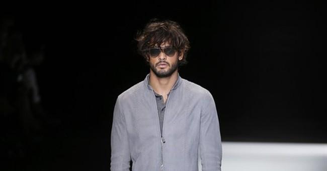 De Niro lights up Armani front row as menswear goes feminine