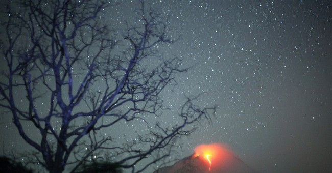 Image of Asia: Lava flows from Mount Sinabung at night
