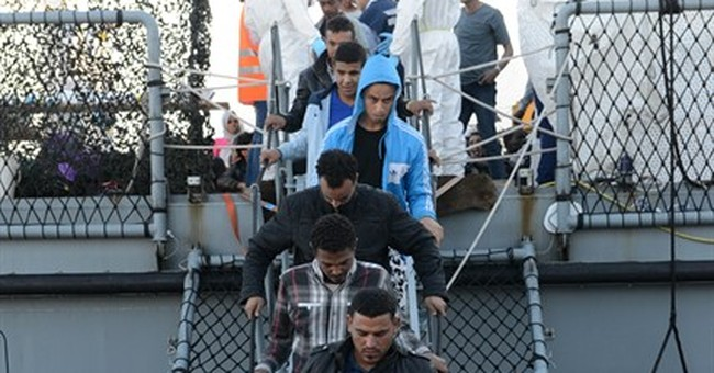 EU urged to improve migrant centers as 1,000 more rescued