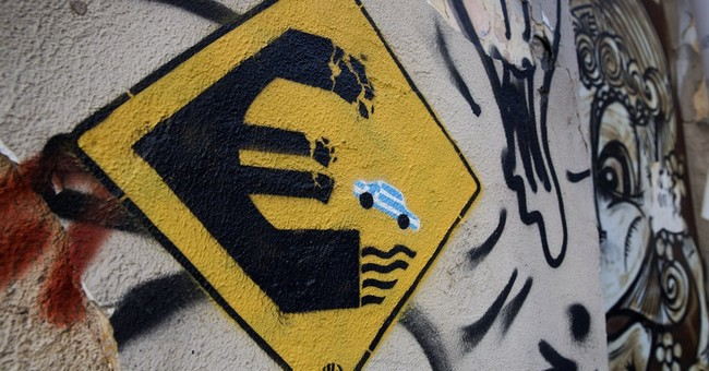 AP PHOTOS: Graffiti artists tackle Greece's financial crisis
