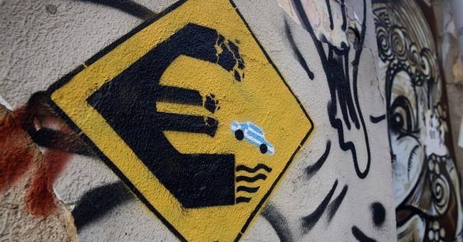 AP PHOTOS: Graffiti artists tackle Greece's financial crisis