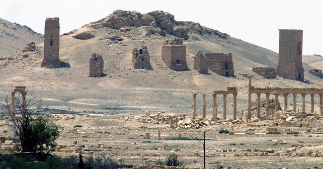 Islamic State group blows up 2 mausoleums in Syria's Palmyra