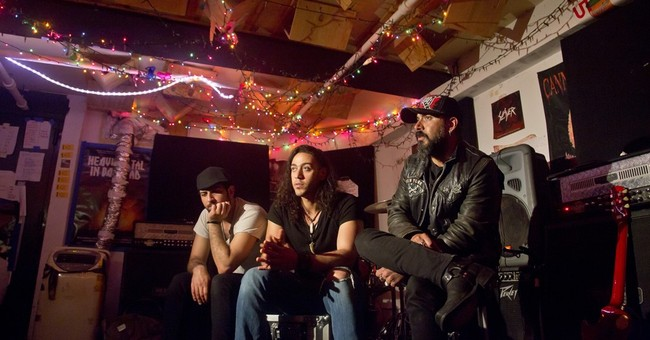Plucked from war-torn Iraq, heavy metal band gets first EP
