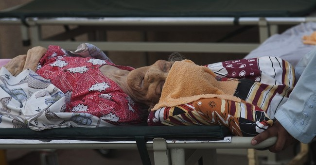 Rains cool Pakistan as heat wave's death toll climbs to 838