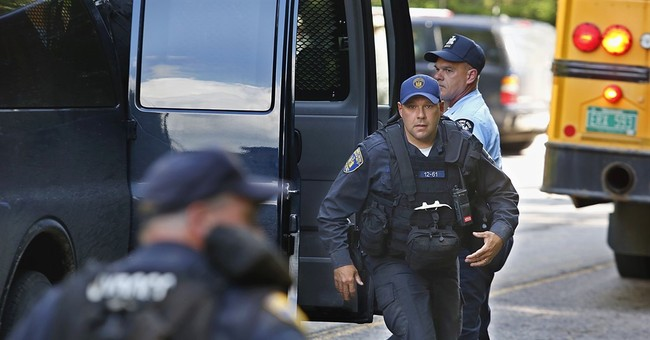 The Latest: Officials say it's not known if convicts armed