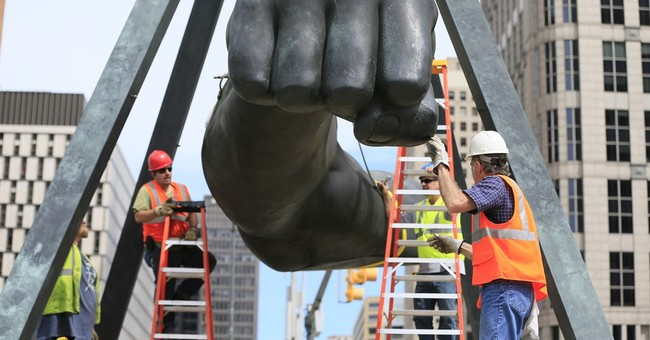 Detroit sculpture of boxer Joe Louis' fist getting fixed up
