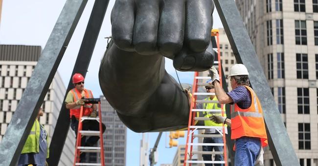 Detroit sculpture of boxer Joe Louis' fist getting fixed up