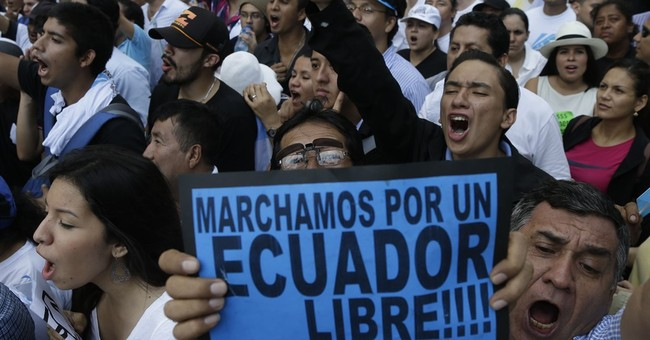Opponents of Ecuador president march in biggest city