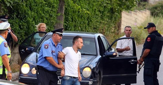 14 arrested, more at large in Albanian marijuana village