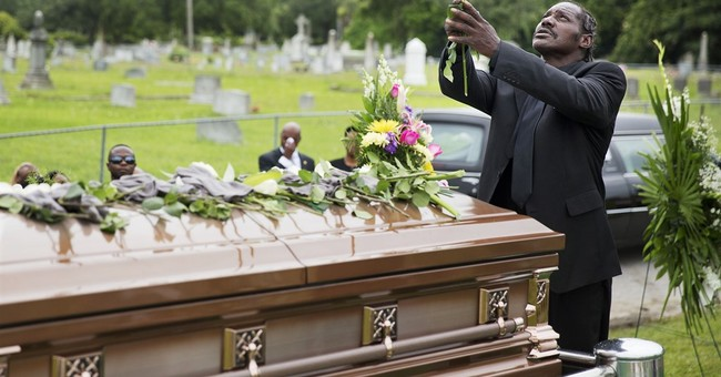 Hundreds attend 1st funerals for church shooting victims