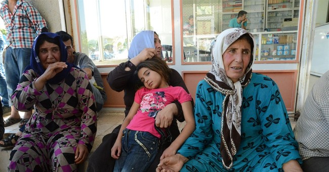 Amid new IS offensive, scores die in Syrian town