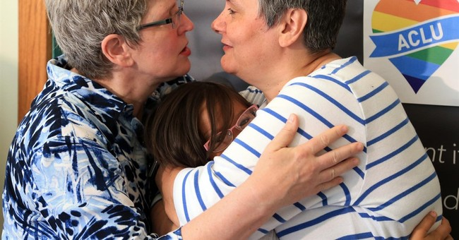 AP PHOTOS: Gay couples celebrate after Supreme Court ruling