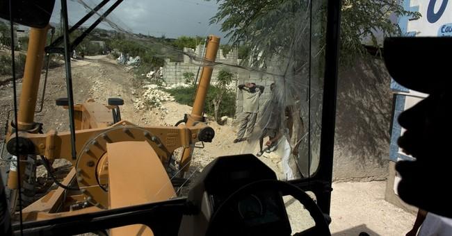 Haiti seeks to control 'city' that emerged from quake
