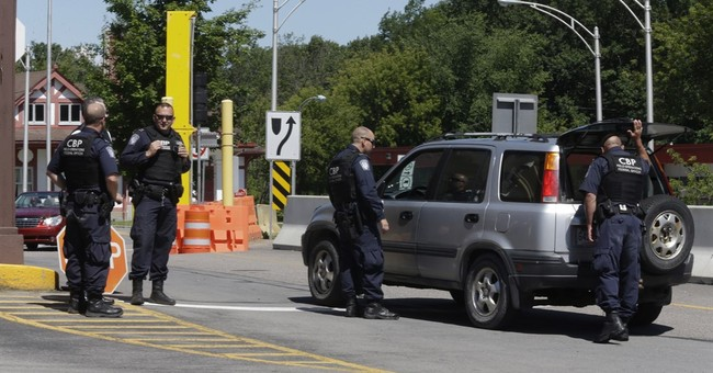 The Latest: Escapee 'shot when he didn't comply'; 1 sought