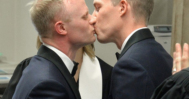 Gay couples wed on historic day as conservatives resist