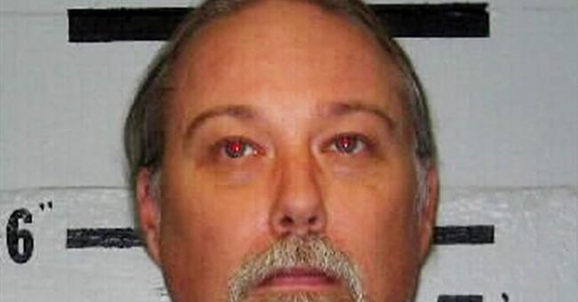 Parole blocked for killer of California man buried alive