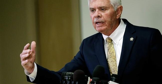 Once open to grand jury scrutiny, Tulsa sheriff fighting it