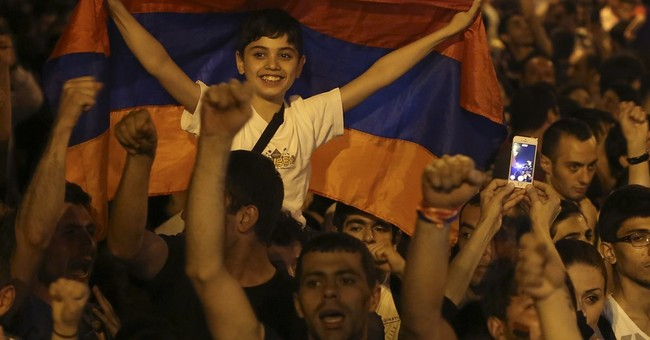 Armenian president suspends electricity hikes behind protest