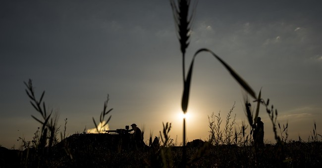 AP Photos: Ukrainian village caught in crossfire of war