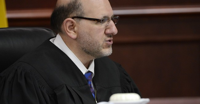 Judge in theater shooting possesses cool head, strong will