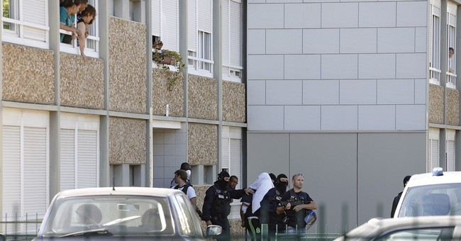 French police escort suspect in beheading to his home