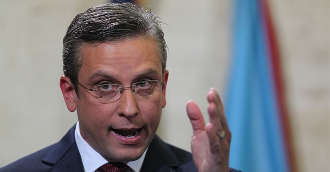 Puerto Rico governor warning that public debt unpayable