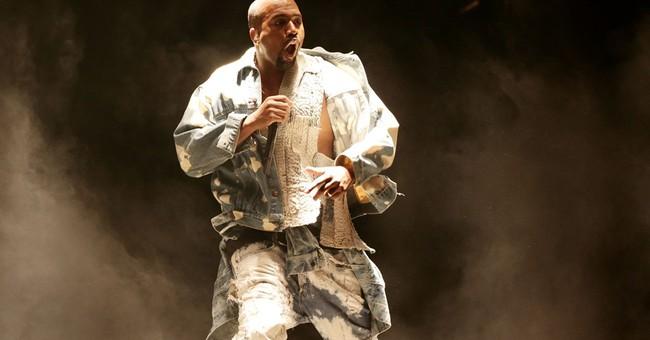 Prankster invades Kanye West stage at Glastonbury festival