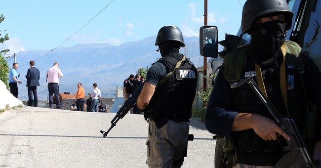 Albania police arrest 2 more suspects in policeman's slaying