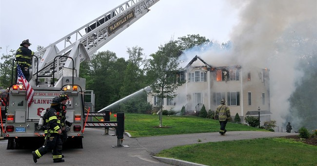 Plane crashes into home, killing 3 aboard; residents escape