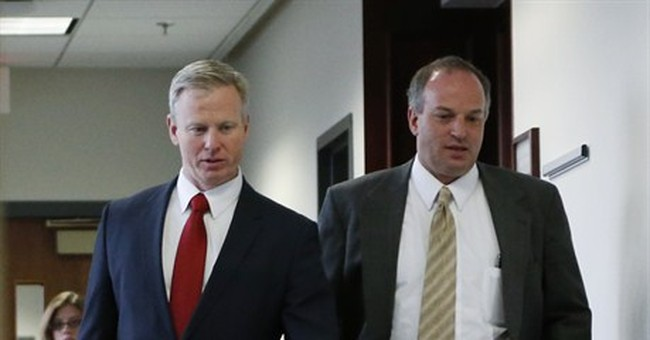Political questions swirl around theater shooting prosecutor