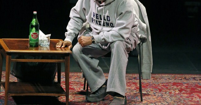 Despite outside protests, Cosby welcomed by Denver audience