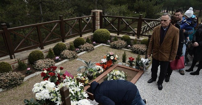 Faithful flock to grave of new Greek Orthodox saint