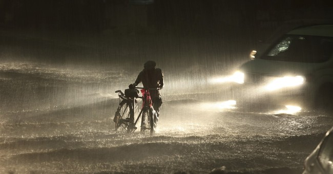 Image of Asia: Walking in an Indian rainstorm