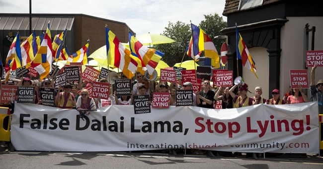 Dalai Lama faces protest as he opens UK Buddhist center