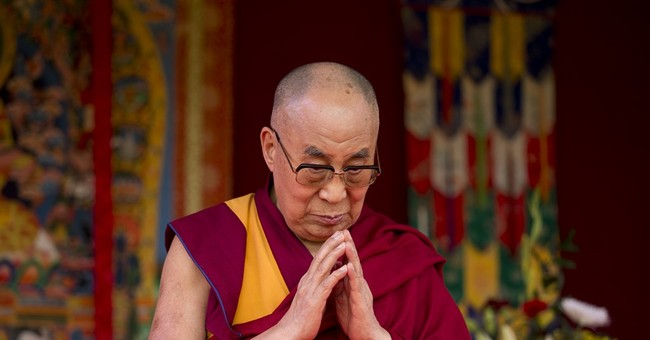 Dalai Lama faces protest as he opens UK Buddhist center