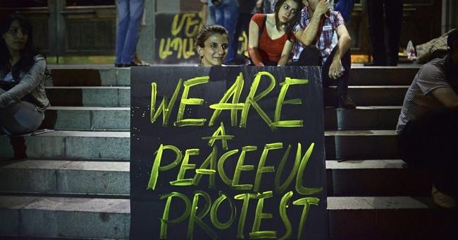 Armenian protesters still defying police after tense night