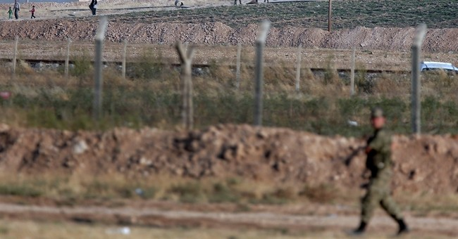 As Kurds gain in Syria, Turkish govt ponders military action