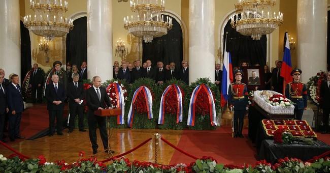 Putin and Russian political elite bid farewell to Primakov
