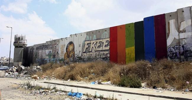 Mural of rainbow flag sparks rare Palestinian debate on gays