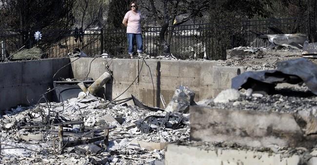 Fire crews make gains against damaging Washington wildfire