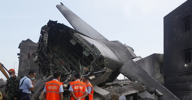 Police: 141 bodies recovered from Indonesia plane crash