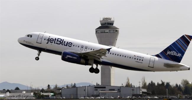 After resisting for years, JetBlue adds checked bag fee