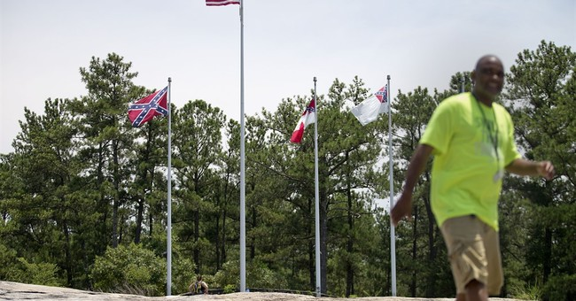 Stone Mountain Park official: Rebel flags must fly under law