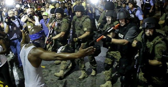 Federal report faults police actions during Ferguson unrest
