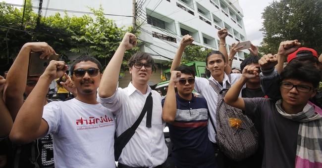 UN rights office urges Thailand to free 14 student activists