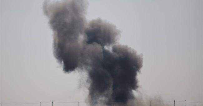 Scores killed as militants attack Egyptian troops in Sinai